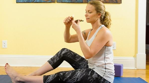 Woman-smoking-pot-and-doing-yoga-780x438