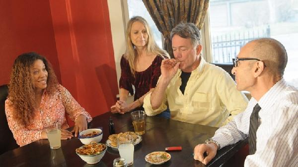 group-adults-smoking-marijuana_7153-780x438